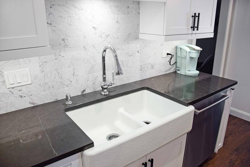 Gray Countertops with veining and farmhouse sink
